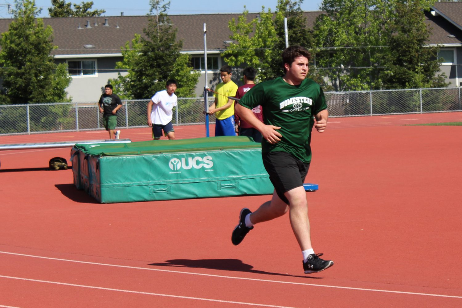 Players condition by running a mile during the practice.
