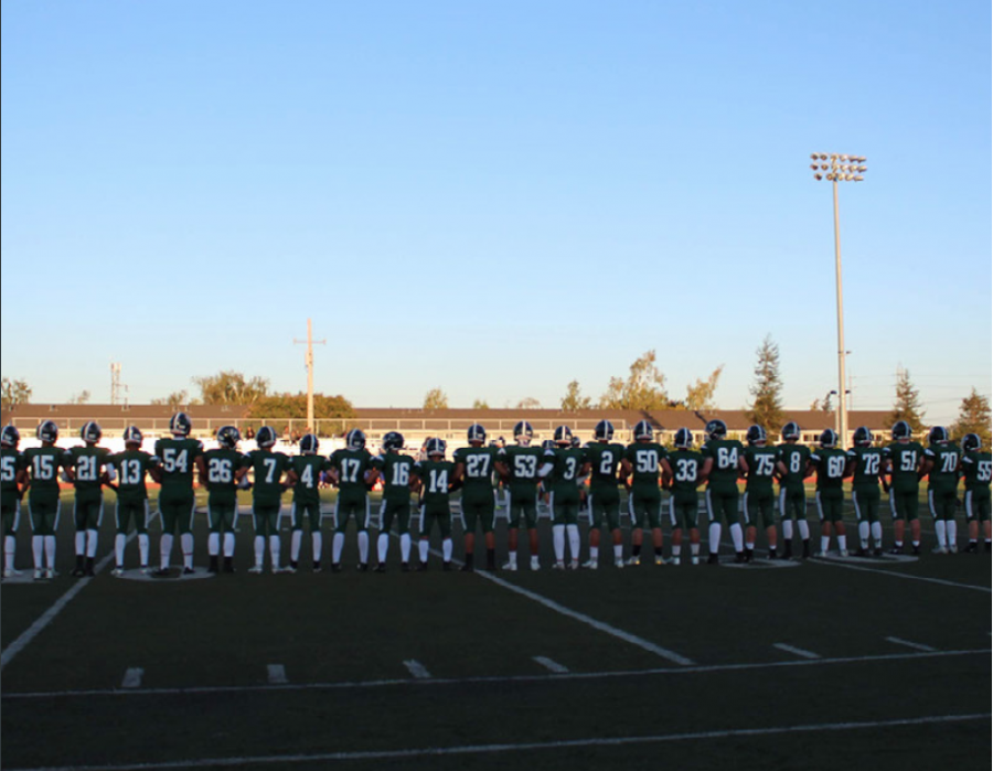The varsity football team lines up at the start of their Sept. 6 game against South San Francisco High School, in which they defeated the Warriors 68-6.
