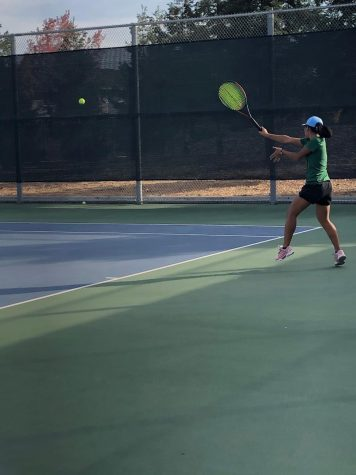 Sophomore Thien-Nhi battles against her Los Gatos opponent in CCS.