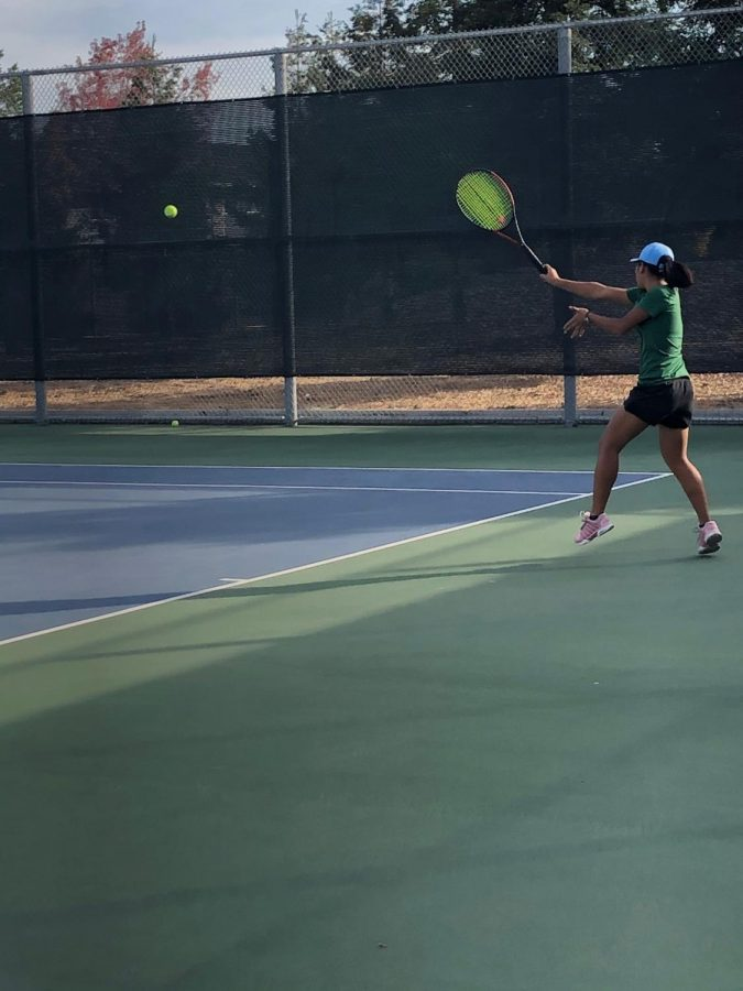 Sophomore Thien-Nhi battles against her Los Gatos opponent in CCS.