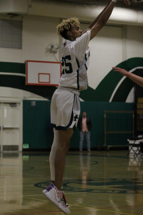 Alex Harris (12) makes a jump shot at the CHS game on Jan. 10.
