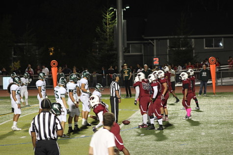 The Homestead and Fremont teams fight to receive the famous red and green bell.
