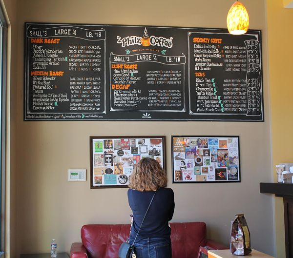 A patient customer browses the variety of organic roasts, teas, and specialty drinks on Philz's menu.