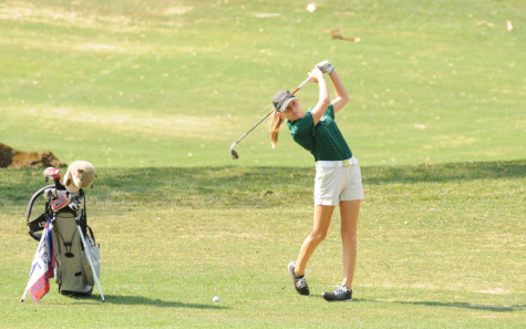 Junior Maddie Thorp takes a swing.