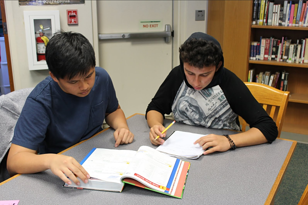 Senior Ryan Chen helps a tutee in various subjects including math and history.