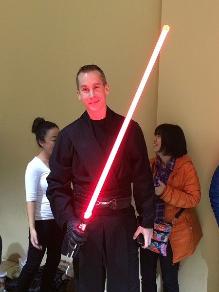 An audience member dressed as a Sith Lord waiting in the movie's queue.