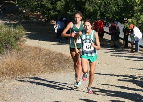 Kamas running in one of her cross country competitions.  Photo by Elena Kamas.