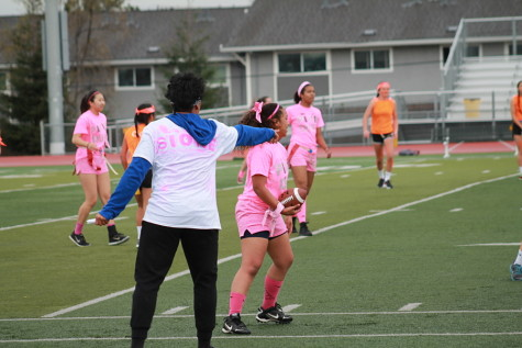 Junior Powderpuff captain Sione Moli directs junior Brooklyn Sylve during the beginning of a play.