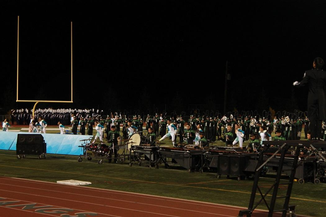On the night of Marching Band EXPO, members are in full action on the field during their performance.