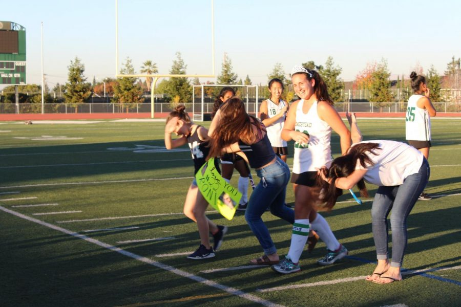 While walking down the field, co-captain and top defensive player Roni Lapede's (12) family dabbed in tribute to her.