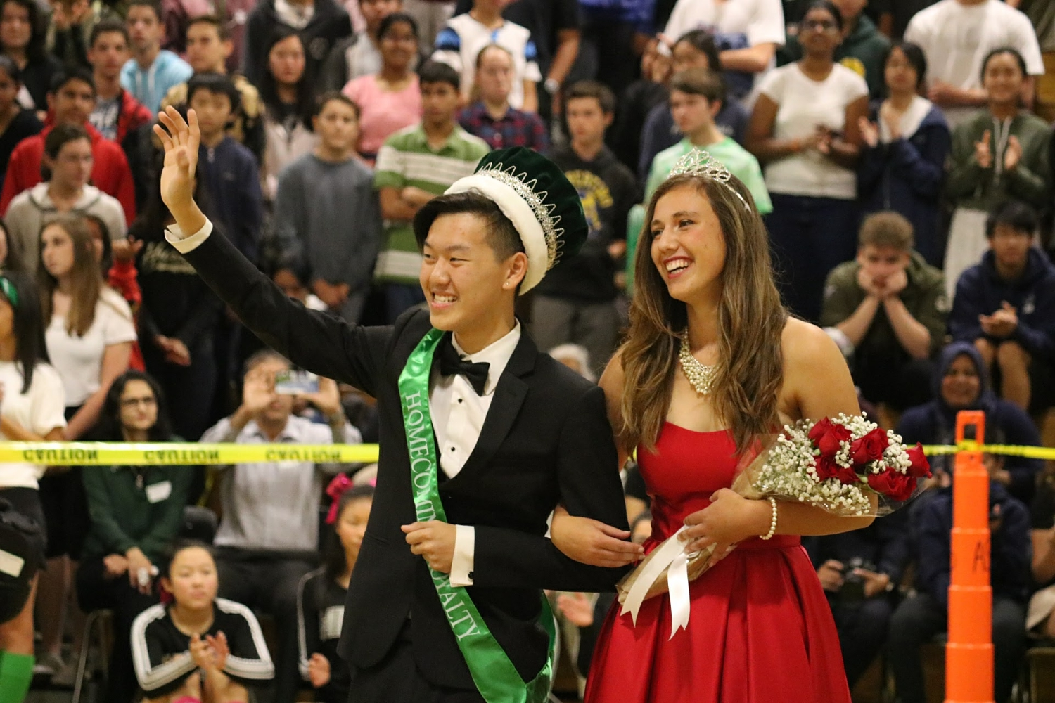 Seniors Simon Lee and Kristina Claras take in their win after being announced Homecoming King and Queen.