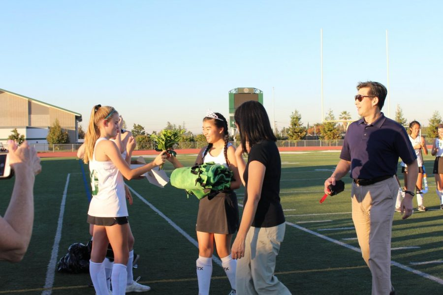 Like other seniors, Lauren Ng (12) received a blanket, a bouquet of flowers and a tiara from their teammates.