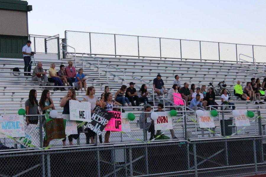 Students, family members and friends showed their support for the seniors through posters and exuberant cheering in the stands.