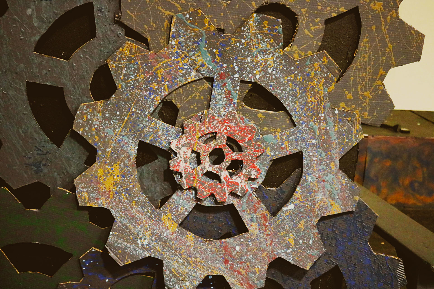 Steampunk cogs covered in paint splatters