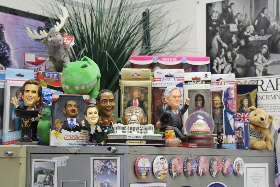 %E2%80%9CIt+started+with+the+Pez+collection%2C+which+%5Bhas%5D+all+the+different+presidents+that+are+behind+the+action+figures.+Then+I+found+one+action+figure+in+the+election+that+John+McCain+and+Obama+were+running+against+each+other%2C+so+I+got+those+action+figures%2C+and+then+there%E2%80%99s+been+like+this+Kickstarter+campaign+for+all+the+other+action+figures.+So+now+I+have+like+a+collection+going+on.+And+the+Obama+that+is+back+there+that%E2%80%99s+made+of+clay%3B+some+student+made+it+in+their+art+class+for+me+%E2%80%A6+I+also+started+collecting+the+dinosaurs+because+of+the+%E2%80%98Tyrannosaurus+Debt.%E2%80%99%E2%80%9D+-Christy+Heaton