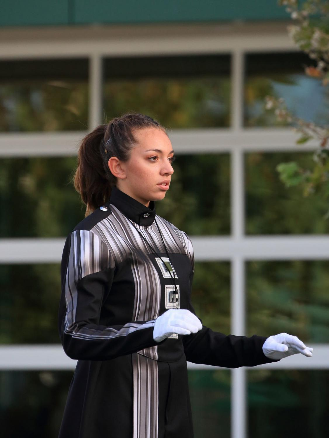 Senior Shani Zuniga is lead drum major for the marching band. This is her ninth year participating in a band program. Photo courtesy of Jim Zumsteg.