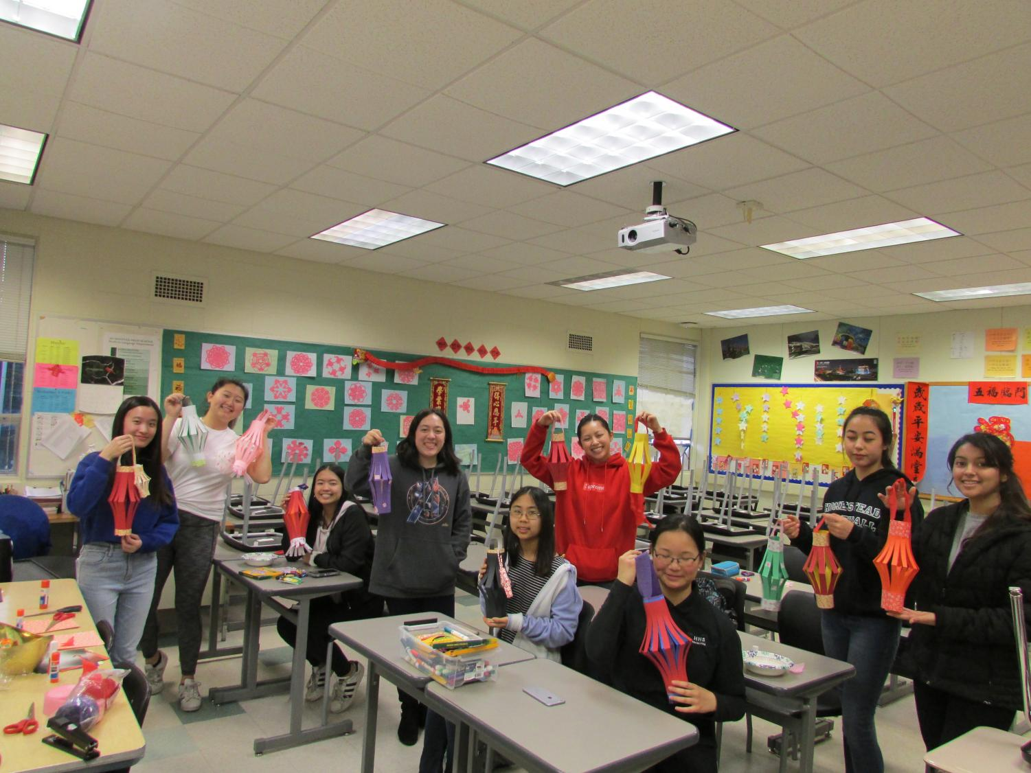 Chinese New Year serves as an occasion on which friends and family can come together. Pictured from left: Joyce Kuo (12), Katherine Dong (12), Alyssa Liang (12), Megan Ikeya (12), Julia Wang (10), Isabelle Law (12), Emily Yao (11), Lily Collins (9), Angelica Ochoa (10).  Photo by Dexter Tatsukawa.