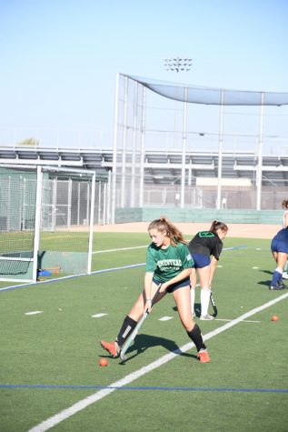 Sophomore Claire Flickner practices on the field with the varsity team wearing her HHS soccer jersey.