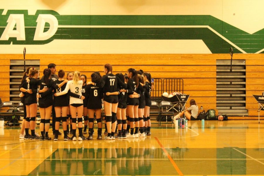 The girls volleyball comes in for a huddle, as they keep their hopes high for the season.