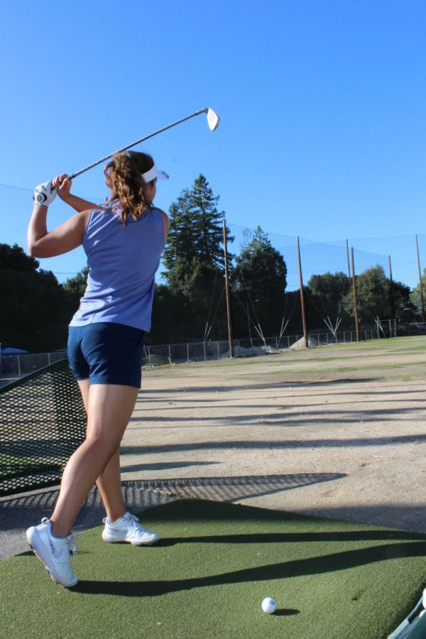 The golf team practices their swings at the range to prepare for the upcoming season.