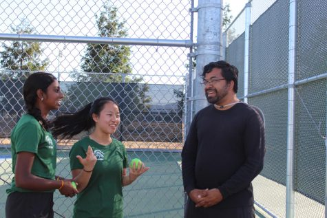 Team captains Brinda Pandi and Belinda Yan confer with coach Sundar Parthasarathy prior to their last home game against LHS.
