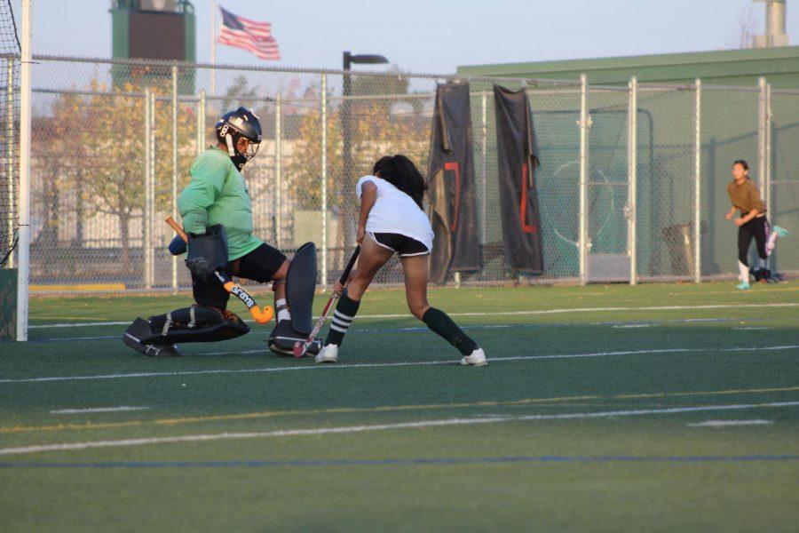 Junior goalie Abisha Muzumder works on blocking shots with junior field player Sanjana Shankar in preparation for their match with Archbishop Mitty on Nov. 9.