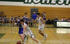 Boys basketball defeated but still determined