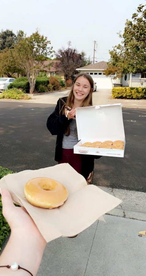 Junior Shelby Riemenschnitter delivers donuts to her friends to maintain an in-person personal connection with them.