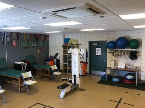 Yusim helps a student athlete in the Athletic Training room, where he encourages all students to visit with any questions they may have about injury prevention or recovery or even just general health and nutrition.