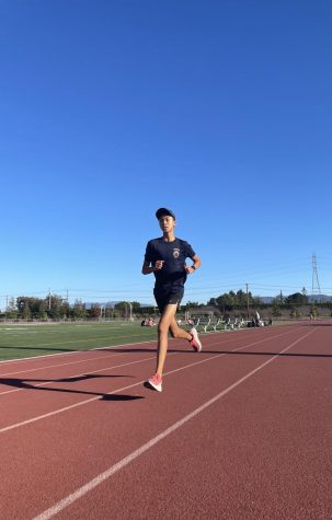 CROSS COUNTRY CONDITIONING: A cross country team member prepares for the fall sports season,
